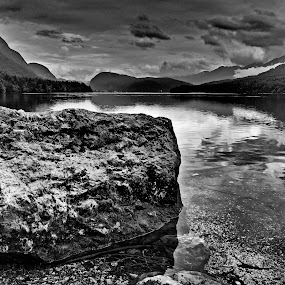 Lake by Matevz Skerget - Black & White Landscapes ( clouds, water, b&w, black and white, fog, stone, lake )