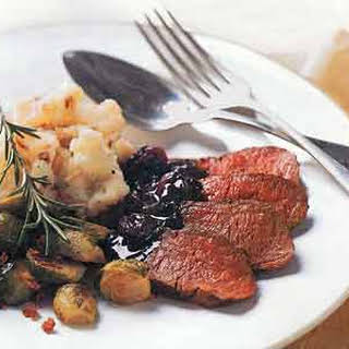 Pan-Seared Venison with Rosemary and Dried Cherries.