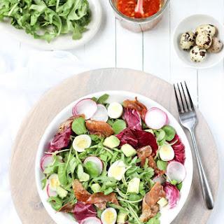 Prosciutto and Quail Egg Spring Salad with a Sesame Asian Vinaigrette