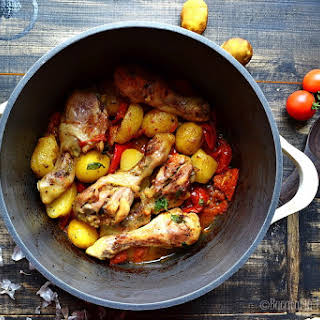 Chicken Drumsticks With Potatoes And Sweet Tomatoes.