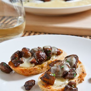 Baked Brie Topped with Caramelized Mushrooms