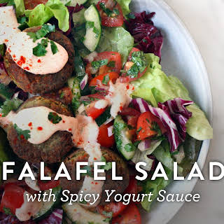 Falafel Salad with Spicy Yogurt Sauce.
