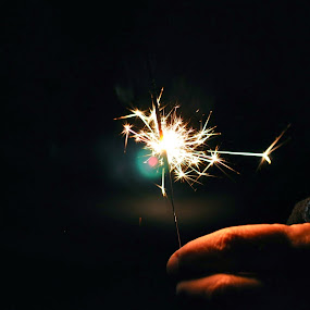 Spark by Ash Swetland - Public Holidays New Year's Eve ( hand, sparkler, fireworks, spark, skin, fire, new years, flame )