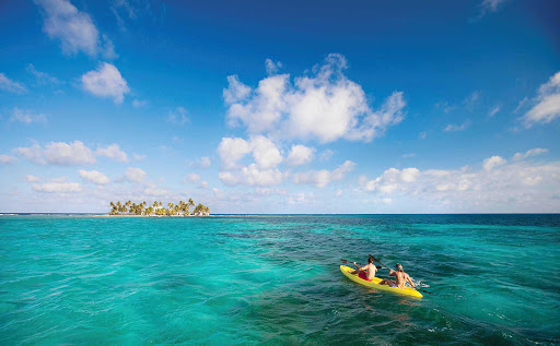 Caribbean-lagoon-couple - Kayaking, snorkeling and other adventures await when you book passage to the Caribbean on Norwegian Cruise Lines.