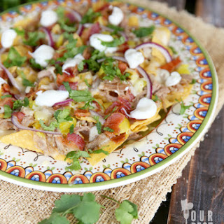 Pulled Pork Nachos with Pepper Jack & Bacon.