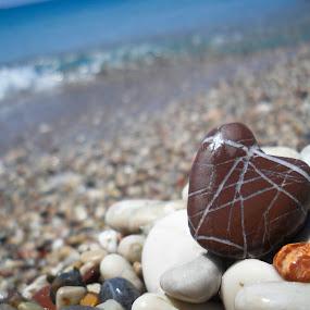Heart Stone by Christian Tiboldi - Nature Up Close Rock & Stone ( beaches, heart, sunny, beautiful, summer, stone, blur, beauty in nature, beach, rock formation, rocks,  )
