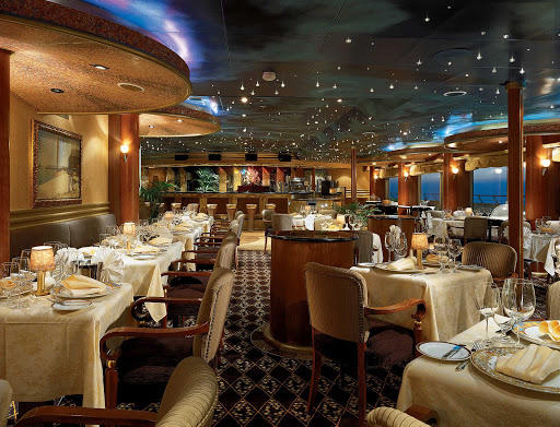 Dine on delicious steaks, lamb chops and seafood at Carnival Conquest's enchanting Point Supper Club.