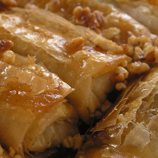 Phyllo Cigars with Date-Pomegranate Filling and Honey Syrup