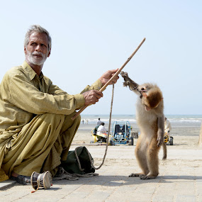 Animal Slavery by Syed Rixvi - People Street & Candids ( poverty, streets, beach, monkey, Travel, People, Lifestyle, Culture )