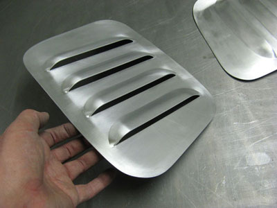 Custom made louvred panel for a racing car