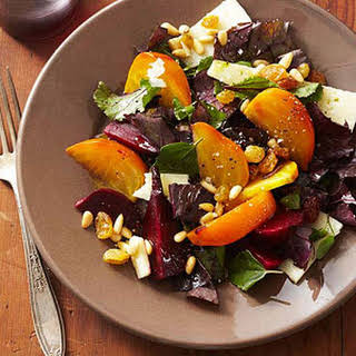 Roasted Beet Salad with Shredded Greens, Golden Raisins, and Pine Nuts.