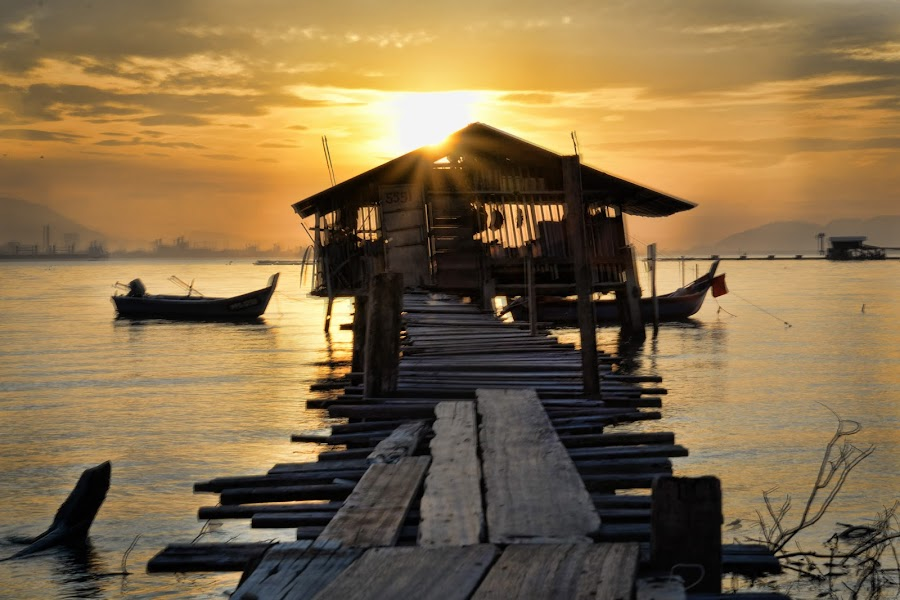 The Sun Rises by Adrian Choo - Landscapes Sunsets & Sunrises ( orange, dilapidated, wooden jetty, old, dawn, penang, jetty, sunrise )