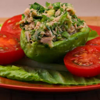 Tuna Stuffed Avocado Salad with Tomatoes, Cilantro, and Lime.