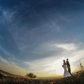 Sunset in two by Vasiliu Leonard - Wedding Bride & Groom ( wedding, sunset, sureal, wedding photographer, vasiliu leonard,  )