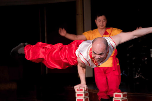 A member of the Hong Kong Folkloric troupe displays an impressive feat of strength and balance during a performance on an Azamara cruise.