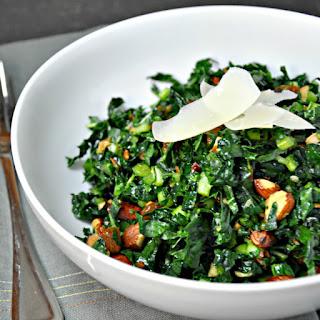 Kale Salad with Almonds and Warm Garlic Golden Raisin Vinaigrette