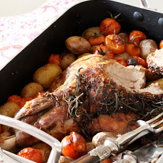 Oven-baked Leg of Lamb with Cherry Tomatoes and Fennel Chutney.